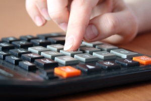 bigstockphoto_Hand_On_The_Calculator_2686754